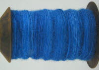 woad dyed singles on spindle